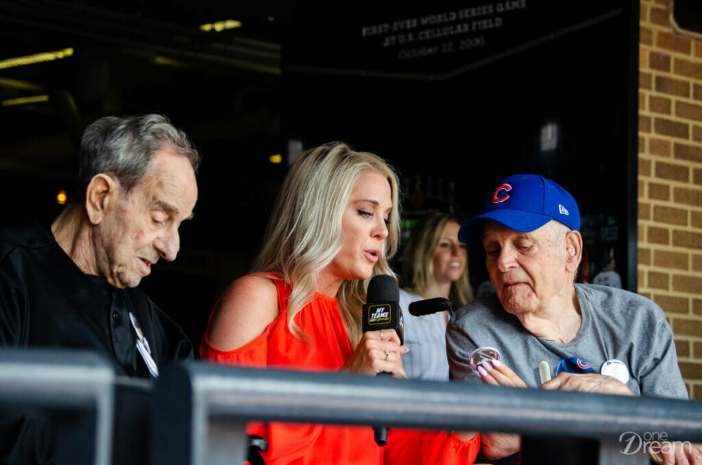 Lou, Kelly Crull and Nick on TV at the crosstown classic